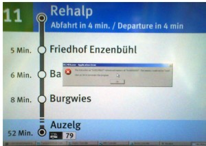 Image of the new station information system in some of Zurich\'s tramways with a Windows GPF on top of the display